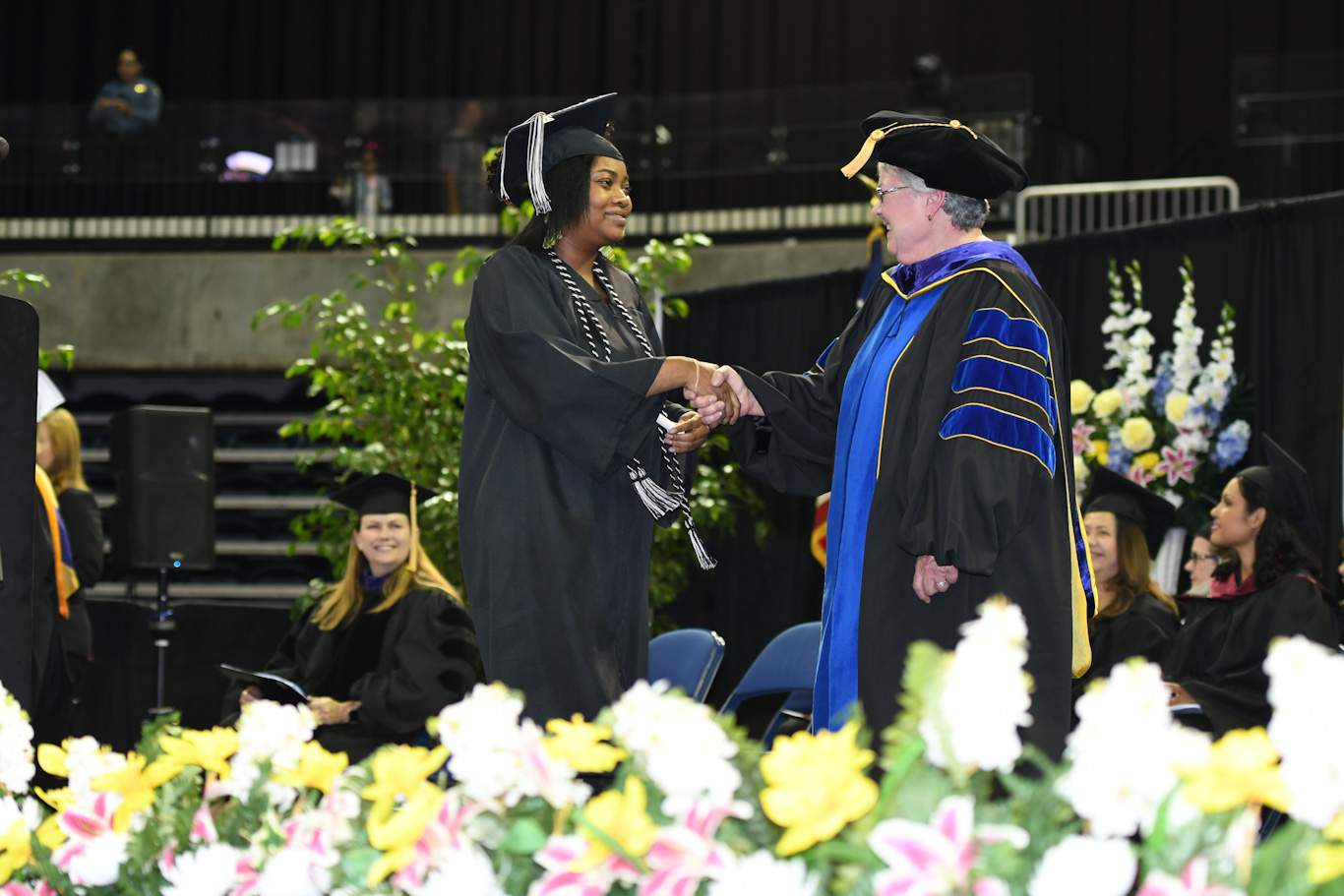 San Joaquin Delta College Superintendent/President Kathy Hart congraulates a graduate at the 2018 Commencement ceremony.