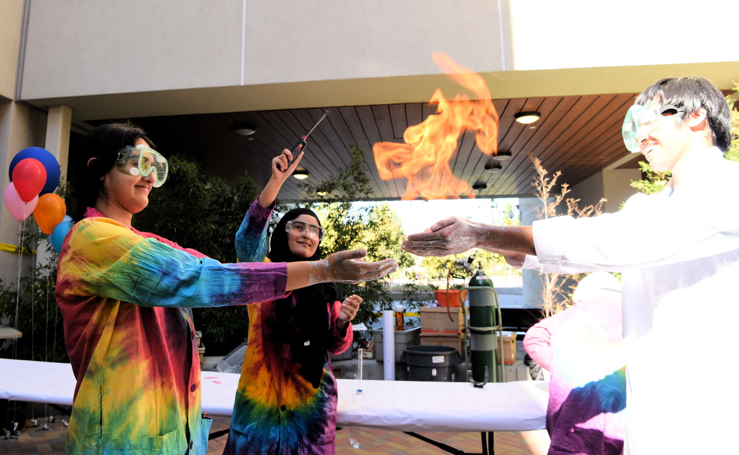 Students perform chemistry experiement