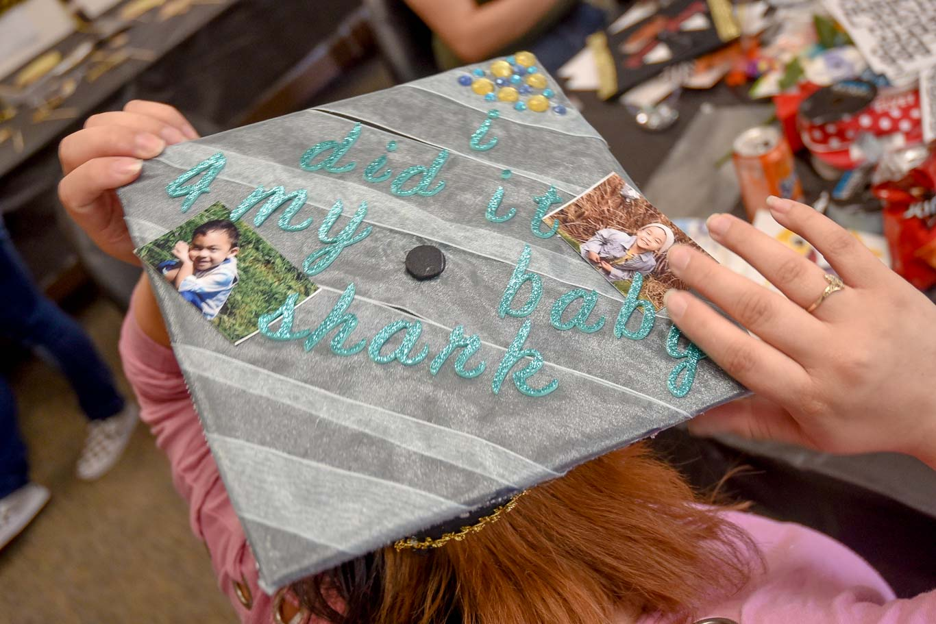 "Sesilie Miranda's commencement cap honors her son Haven, who is a big ""Baby Shark"" fan. Sesilie will graduate from San Joaquin Delta College with an accounting degree."