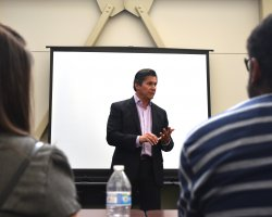 Chancellor Eloy Oakley speaks with classified employees during his visit to San Joaquin Delta College.
