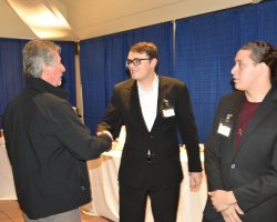San Joaquin Delta College welding instructor Alex Taddei, left, shakes hands with students Cole Clark and Lorenzo Duenas after the Entree to Employment event.