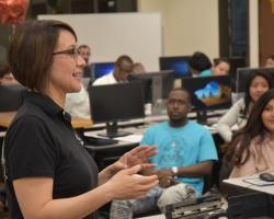 "Professor Alicia Stewart addresses students and community members during the recent ""GO LIVE with Top 25"" event for job hunters"