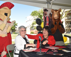 Delta College Superintendent/President Kathy Hart and Stanislaus State President Ellen Junn smile after signing an agreement that will allow Delta students to transfer to Stanislaus and take all of their classes at the university's Stockton campus.
