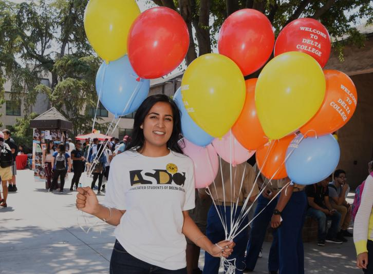 ASDC students stands with balloons