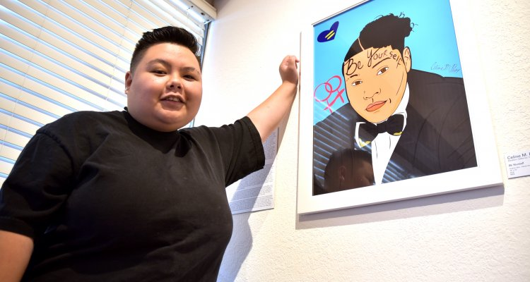 "San Joaquin Delta College student Celine Pham stands beside her piece, ""Be Yourself."""