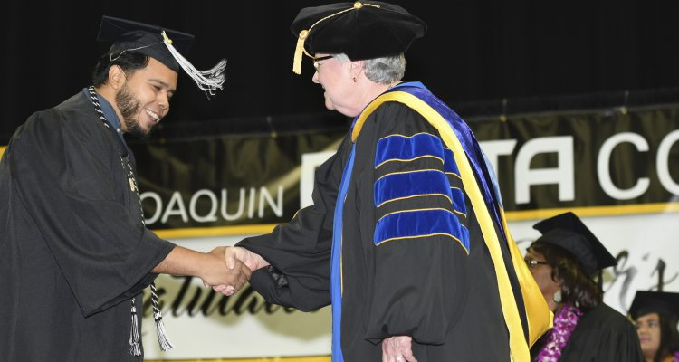 San Joaquin Delta College President Kathy Hart greets a new graduate after the College's 84th annual Commencement ceremony at Stockton Arena on May 23.