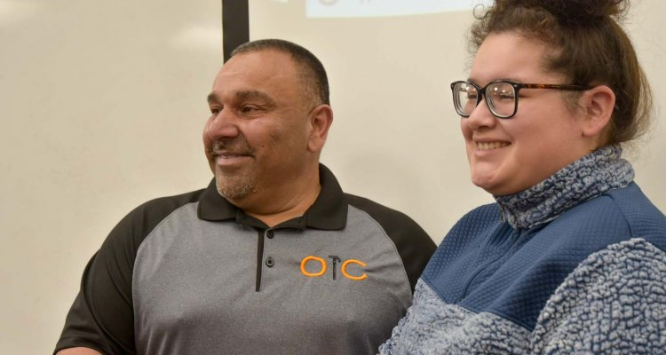 Business owner Martin Ortegon meets with a San Joaquin Delta College student after class last week. Delta students are helping him market his small construction business.