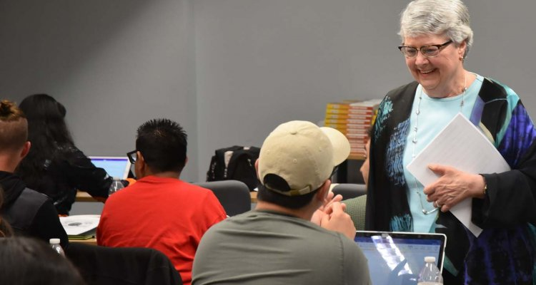 Delta College Superintendent/President Kathy Hart visits with students during one of seven workshops that aimed to instill them with leadership skills. The workshops gave students a chance to learn from and interact with top College leaders.