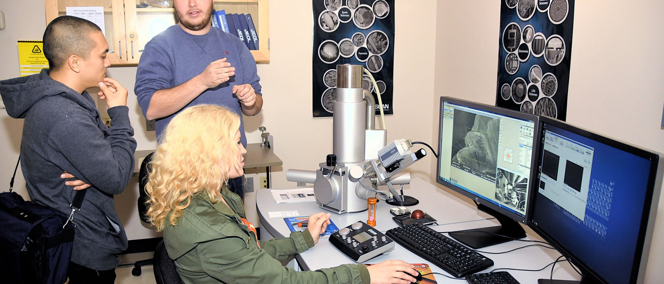 Faculty and student work in the electron microscopy lab