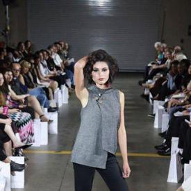 student performs in fashion show