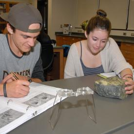 Students study in geology class.