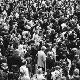 People stand in crowded street